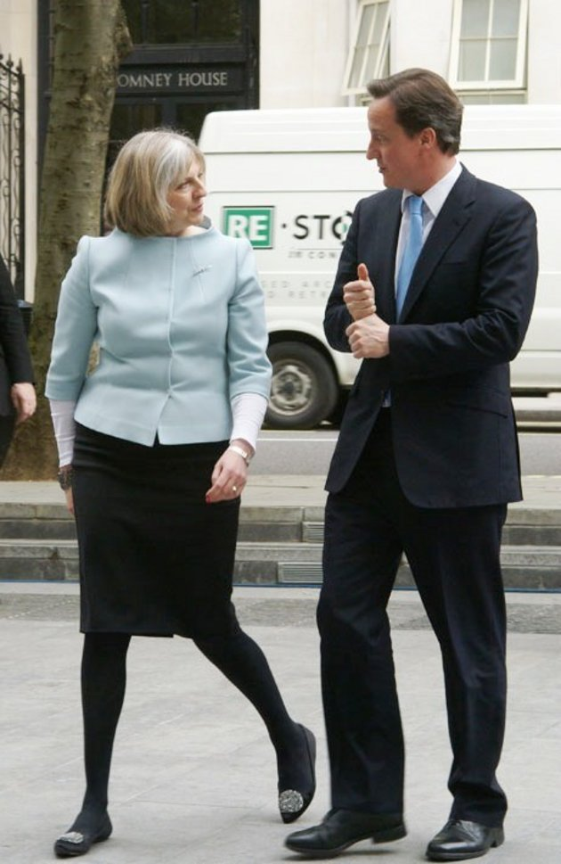 1Prime Minister David Cameron is met by Theresa May on his first visit to the Home Office in May 010; @ ukhomeoffice / Wikimedia Commons CC BY .0